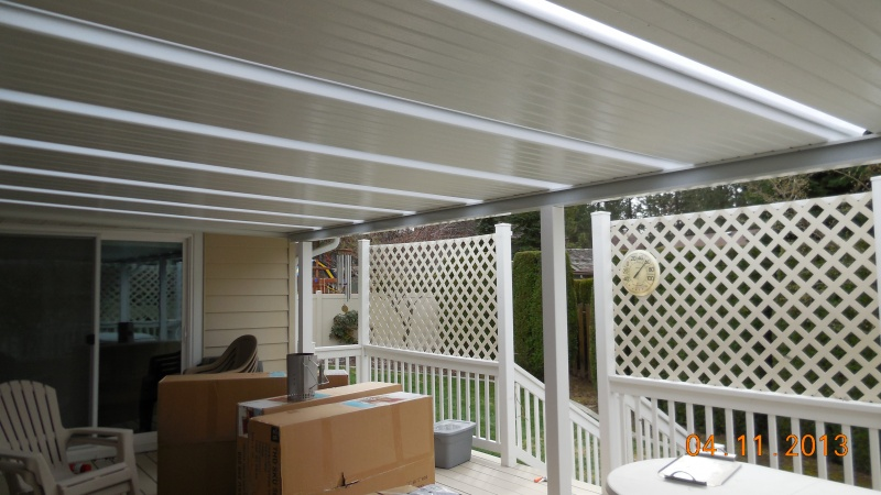 Aluminum patio cover with skylights and posts for additional support