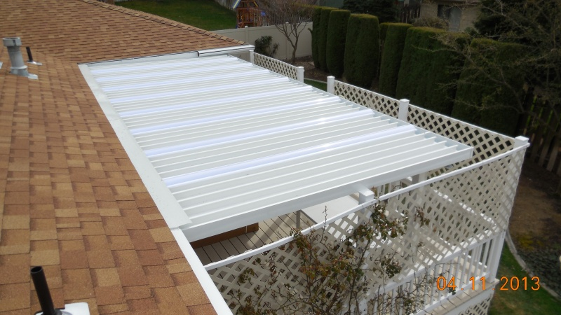 Roof top view of aluminum patio cover and skylights