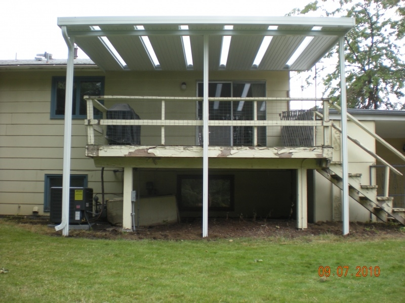 Aluminum patio cover over old wooden deck