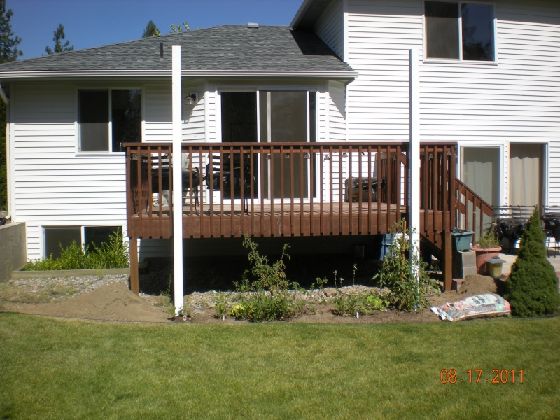 Construction of aluminum patio cover posts outside existing deck