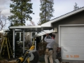 Aluminum awnings being built over walkway