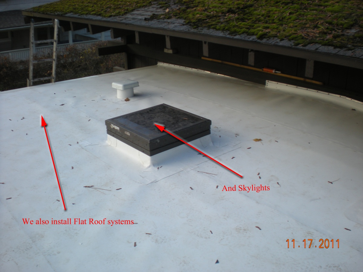 Installing TPO On A Flat Roof With A Skylight And Vent