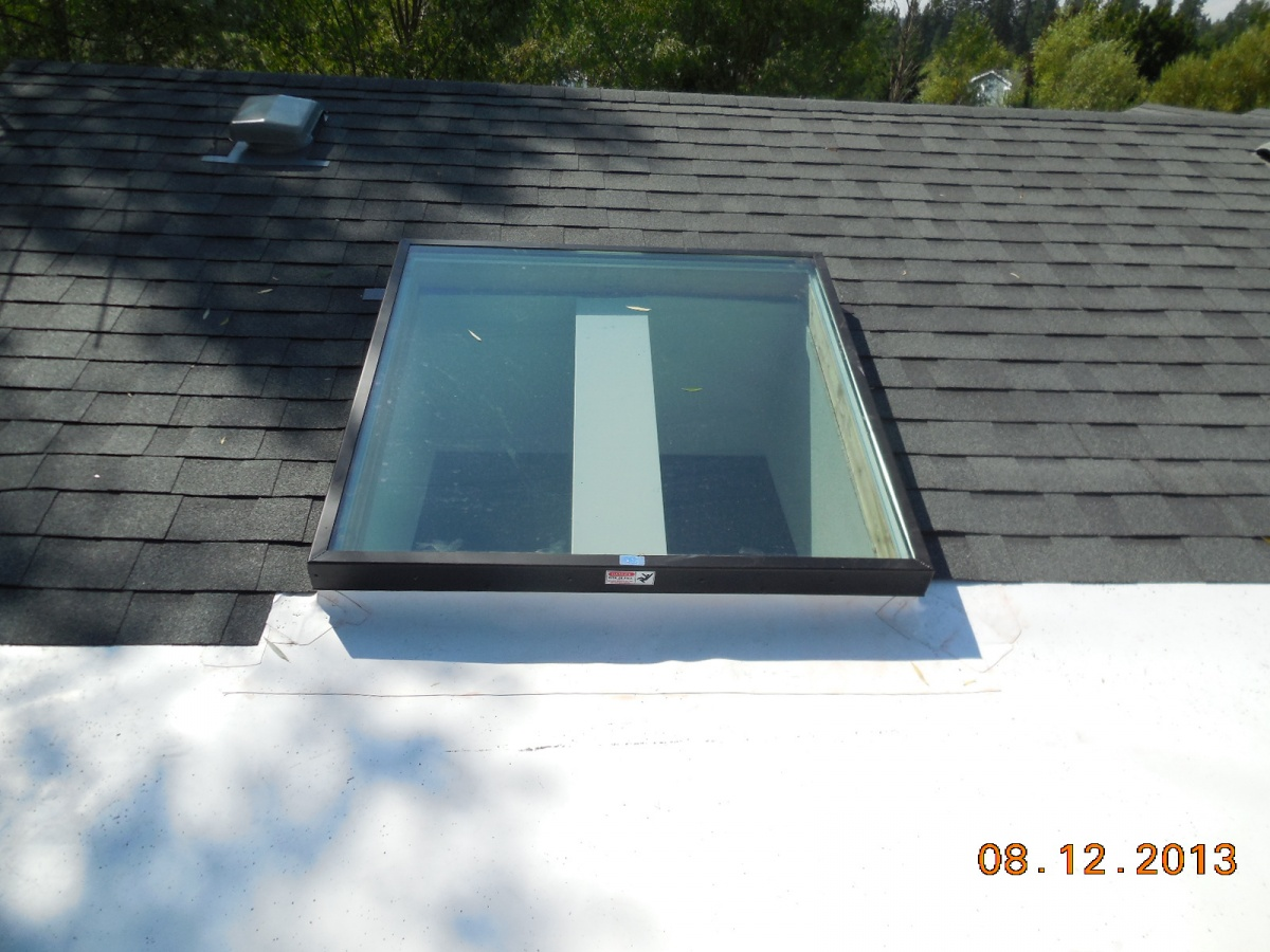 TPO Installed Around The Front Of A Skylight Curb At The Low Slope End