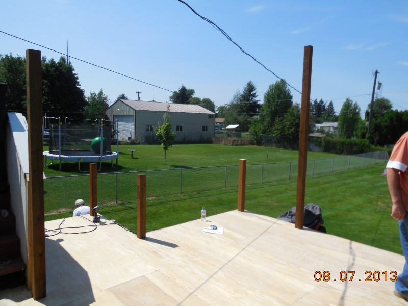 Deck being built in addition to aluminum patio cover