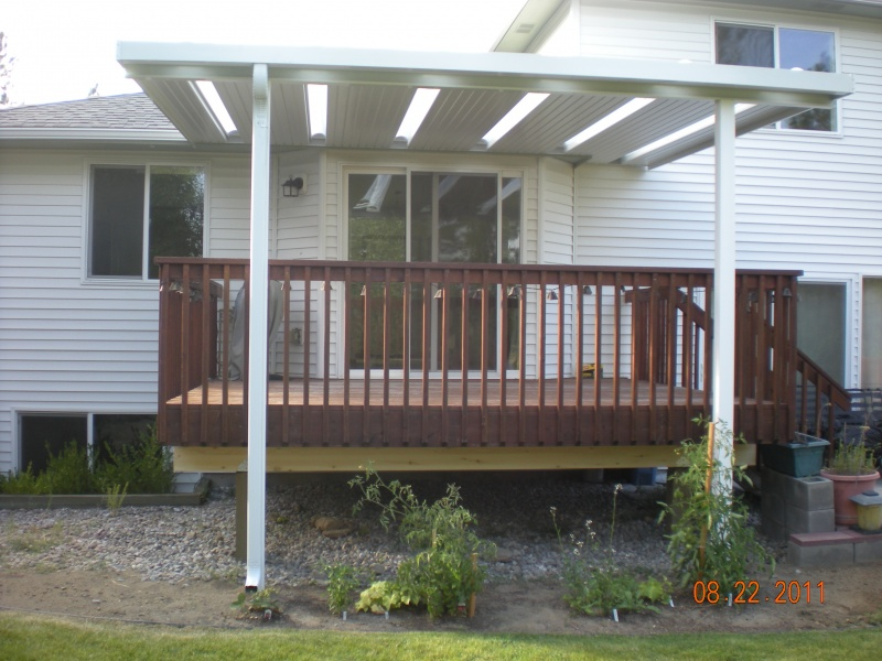 After completion of aluminum patio cover with skylights over existing wood deck