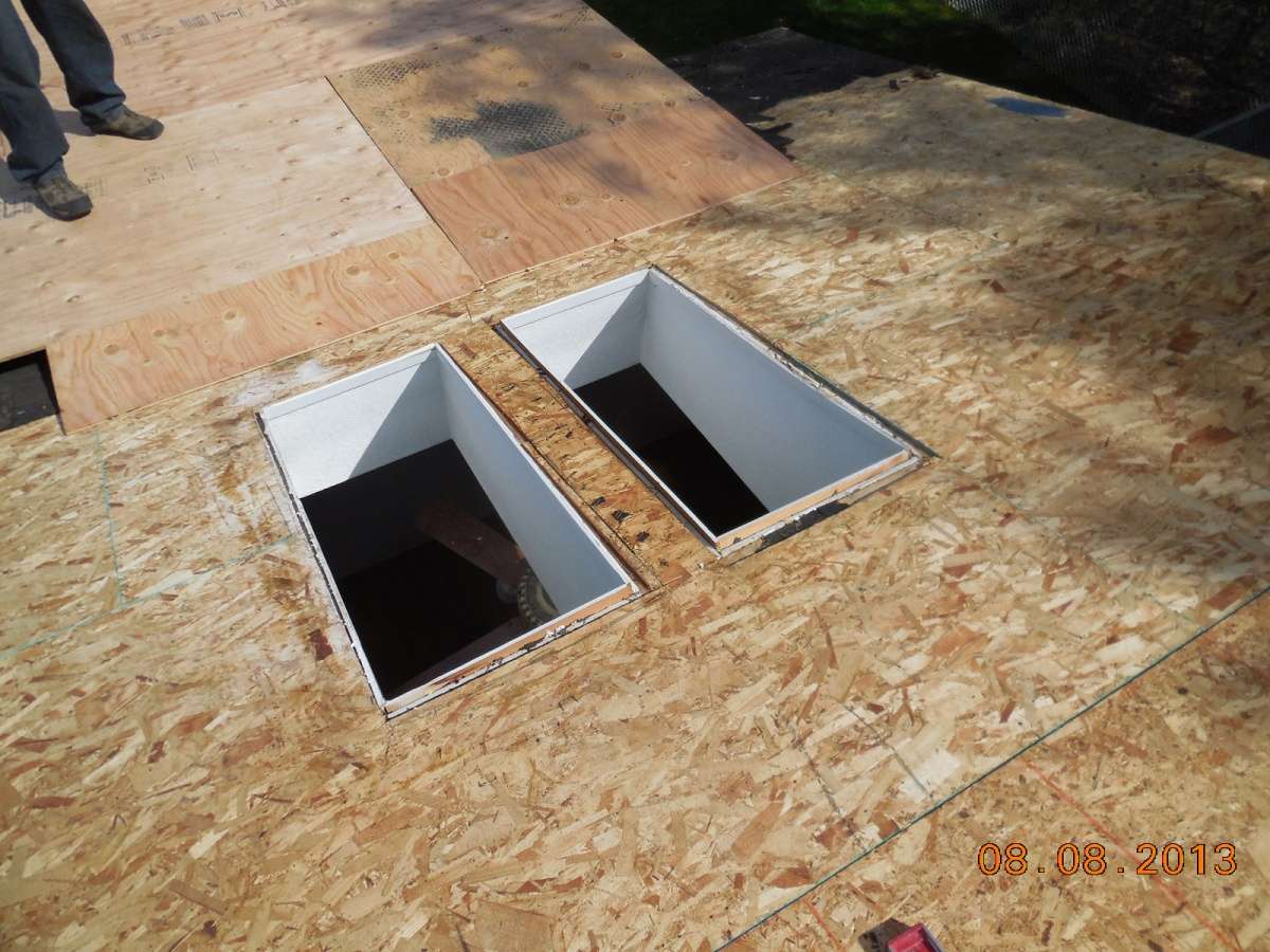 OSB board sheeting around 2 skylights