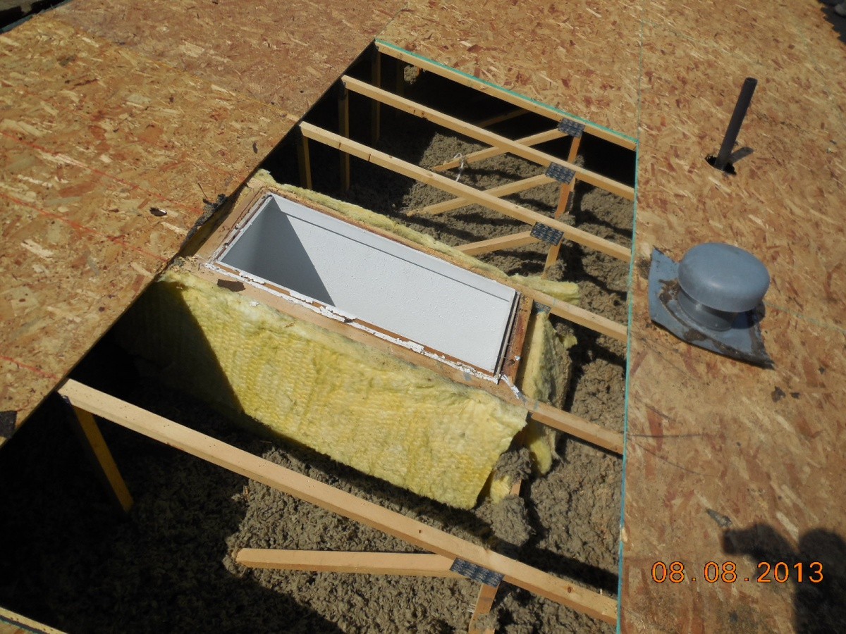 Skylights being replaced during re sheeting of OSB board