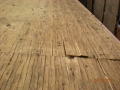 Delaminated plywood roofing deck sheeting