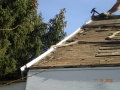 Removing mutiple layers of roofing before re sheet showing side aluminum fascia needing to be trimmed down
