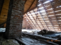 Spaced sheeted roof deck seen from inside attic