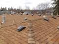 Laminated Owens Corning Tru Def roofing shingles with sun tunnels and RV-49 roof vents
