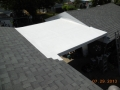 Re roofing home with laminated roofing shingles on house and garage with TPO rubber roof on the low slope breezeway area