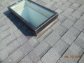 Flat skylight installed with Owens Corning Oakridge roofing shingles