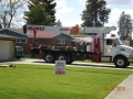 Boom truck for hoisting TPO and fiber board up on flat roofs