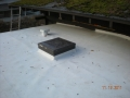TPO rubber roof with side wall rubber flashing, skylight and moisture vent