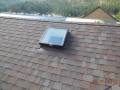 Laminated, architechtural roofing shingles on steep pitch roof with flat glass skylight and ridge vent