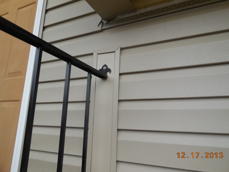 Dutch Lap vinyl siding and matching color-aluminum trim wrapped around hand railing