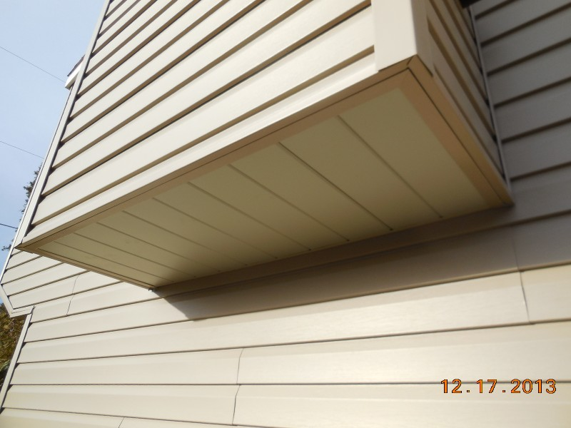 Chimney chase with Dutch Lap vinyl siding and aluminum soffit covering the bottom