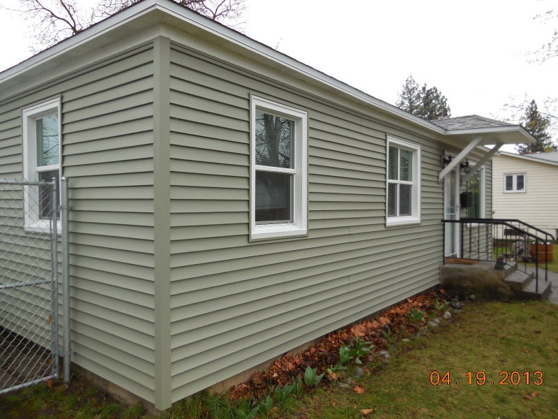 Mastic vinyl carvedwood siding and aluminum soffit, fascia and window casings