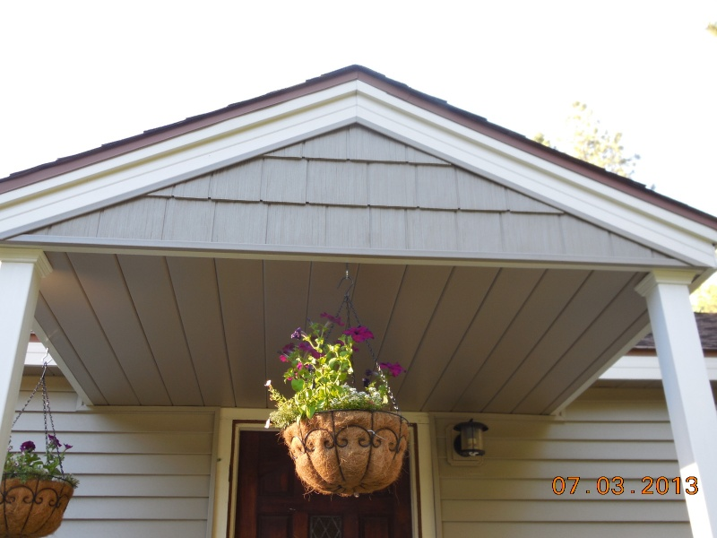 Gable enhanced with vinyl shake siding, aluminum fascia and underside aluminum soffit