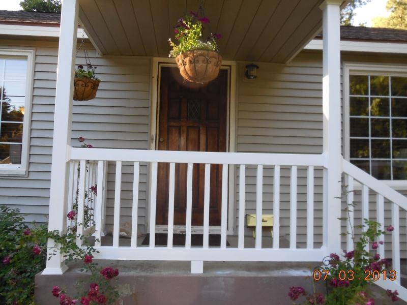Vinyl siding with aluminum handrailngs pvc sleeved posts and vinyl windows
