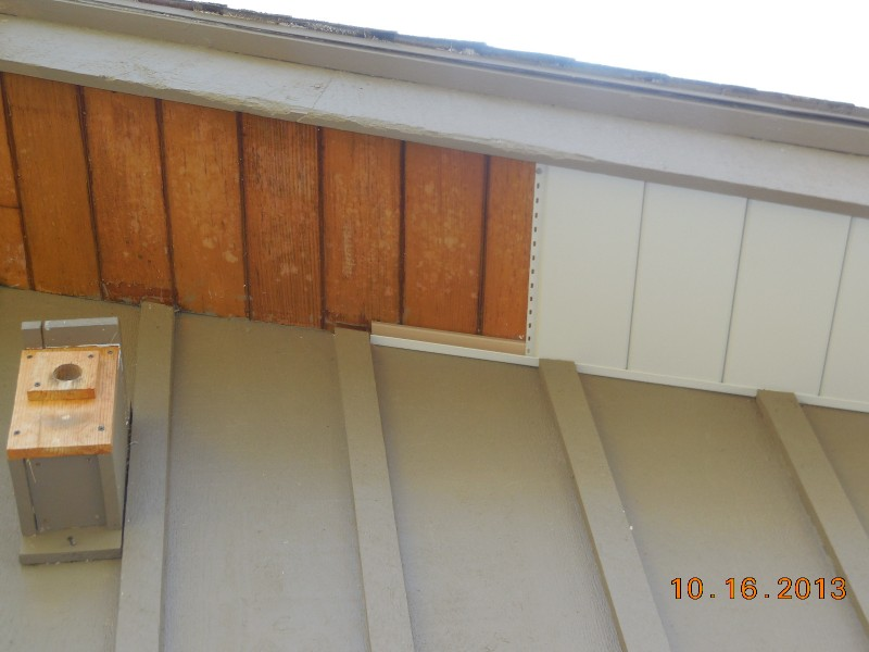 Installing aluminum soffit over old shellaced wood soffit