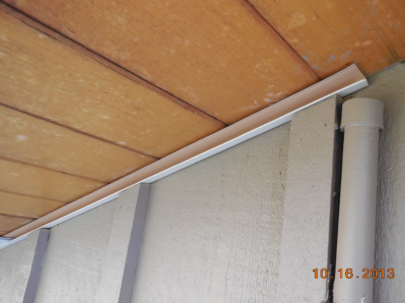 Installing aluminum soffit j-channel to hold aluminum soffit in place