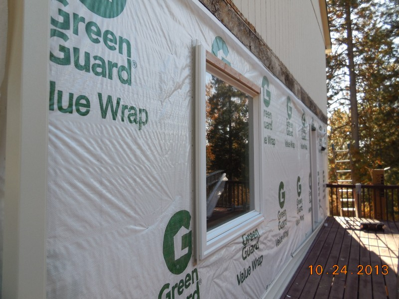 House wrap installed before vinyl siding and window trim