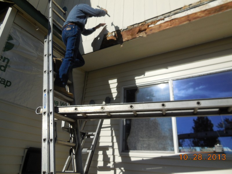 Rotten wood being removed. Caused by incorrect flashing on LP siding installation from the 1990\'s