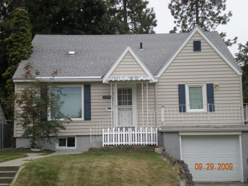 "After vintage house gets 7"" vinyl siding, vinyl windows, shutters, doors, gable trim"