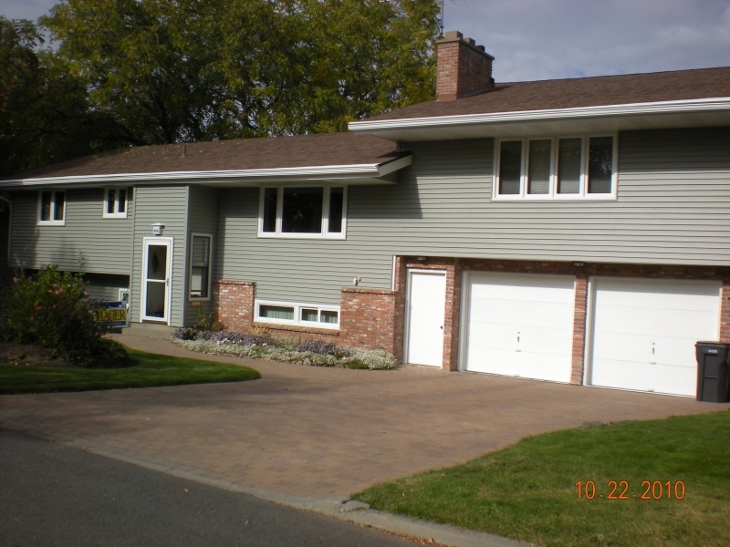 "6"" lifetime vinly siding and vinyl energy star rated windows with aluminum garage door and window trim"
