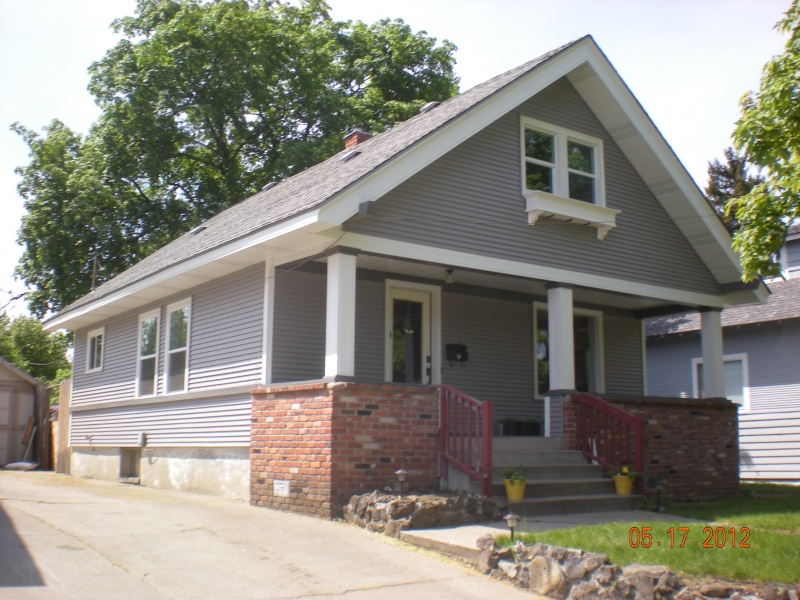 """After 3"""" vinyl siding, vinyl windows, custom porch posts and aluminum soffit and fascia with upper flower box"""