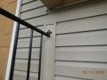 Dutch Lap vinyl siding and matching color-aluminum trim wrapped around hand railing