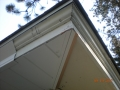 Covering peeling paint under wood soffits and over wood fascia with aluminum