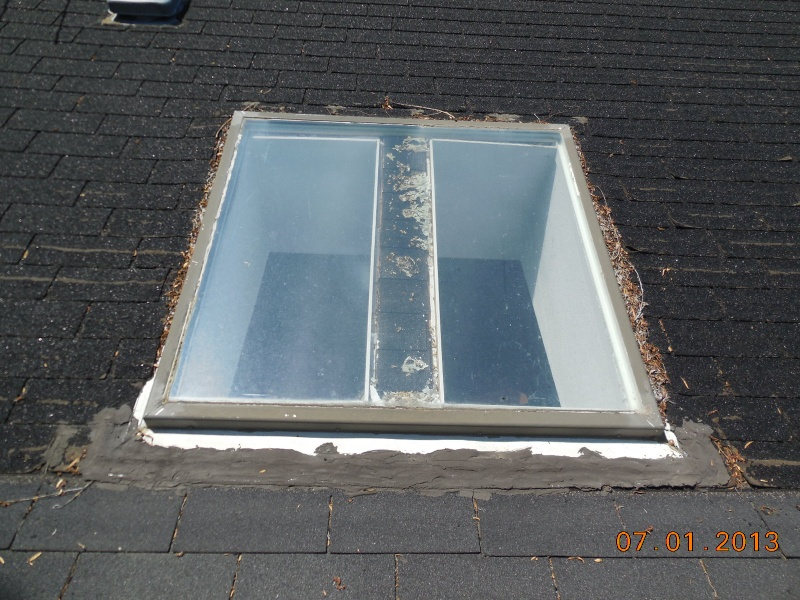 before skylight replacement on low slope