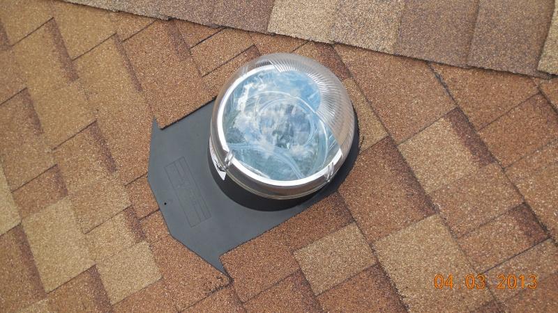 sun tunnel domed skylight on laminated roof