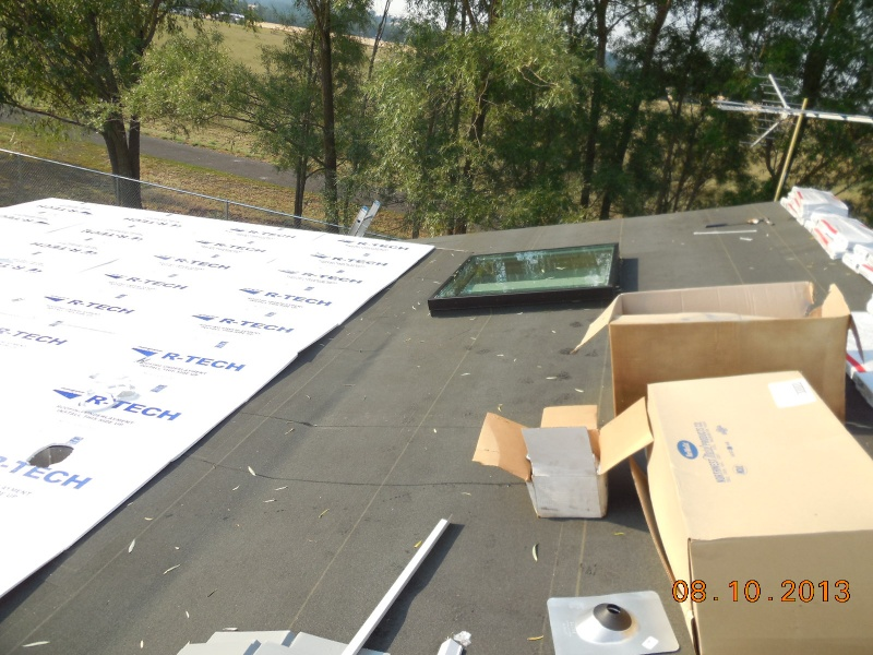 building up skylight curb off low slope roof deck