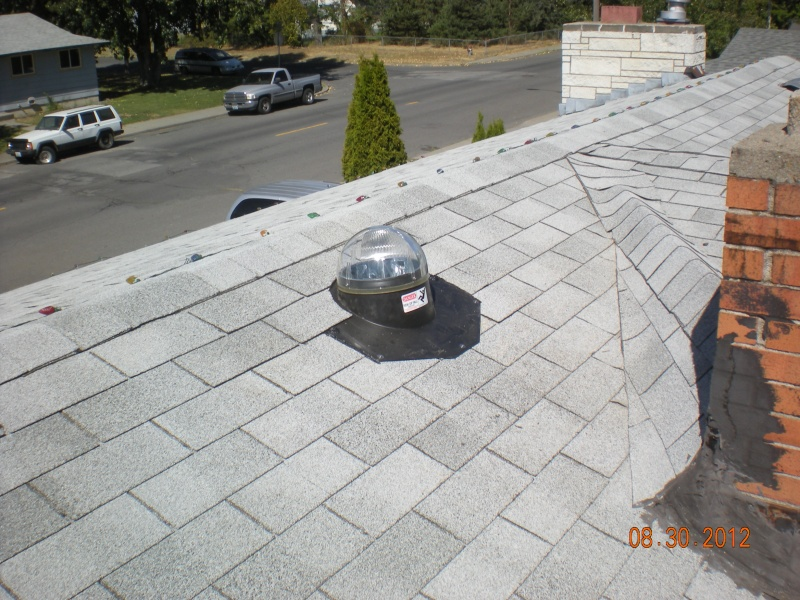 sun tunnel installed on 3-tab roofing