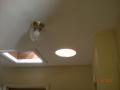 installation of sun tunnel in dark hallway