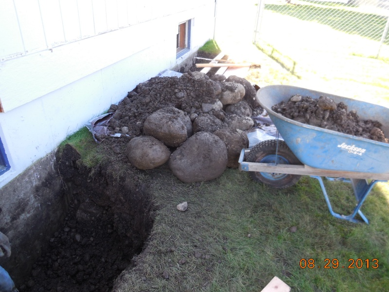 egress window well hole being dug