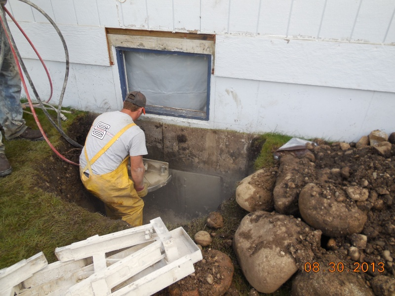 cutting the cement foundation for egress window