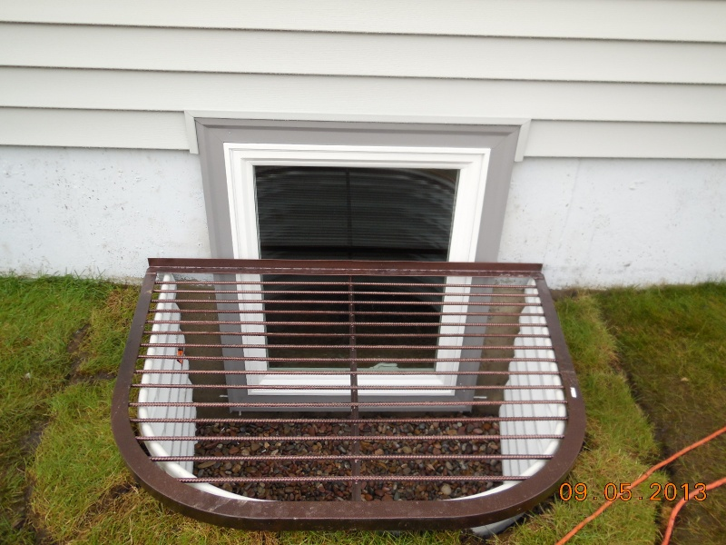 egress window with aluminum wraps and vinyl siding