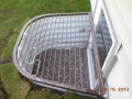egress window well and safety grate with ladder